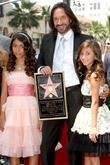 Marco Antonio Solis and daughters