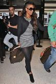 Mel B, aka Mel B, her husband arrive at LAX airport on a Virgin Atlantic flight from London Heathrow.