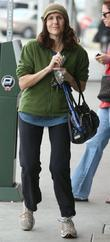 Molly Shannon smiles at photographers while getting coffee...
