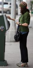 Molly Shannon seen putting money into a parking...