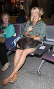 natasha henstridge waits for a passenger to arrive