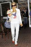 Paris Hilton holds her Pomerainian dog named 'Marilyn...