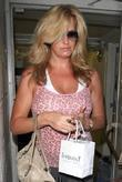 Penny lancaster  tries to exit the Thibiant...