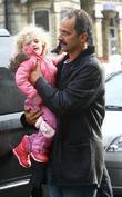 Peter Andre's daughter Princess Tiaamii is carried by...
