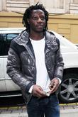 Manchester City striker Benjani Mwaruwari leaving the Radisson Edwardian hotel