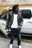Manchester City Striker Benjani Mwaruwari Leaving The Radisson Edwardian Hotel