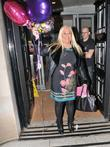 Vanessa Feltz carries a handful of 'Good Luck'...