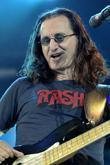 Geddy Lee of RUSH performing live on stage...