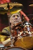 Neil Peart of RUSH performing live on stage during 'Time Machine Tour' at the Molson Canadian Amphitheatre.
