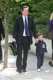 Prime Minister David Cameron walking his son Arthur...