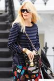 Claudia Schiffer  after dropping her children off...