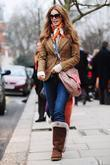 Elle Macpherson returns from the school run London,...