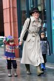 Sharon Stone, Bundled Up Against The Cold, Rain and Takes Her Children To The Doctor's Office In Beverly Hills