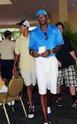 Alonzo Mourning (R) and his son Alonzo Mourning...
