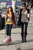 Teri Hatcher and daughter Emerson Rose hold hands...