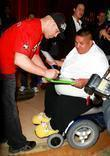 Tito Ortiz signs an autograph for fan Bryan Eaglehelper