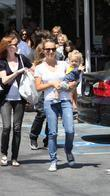Jennifer Meyer with her son Otis Tobias Maguire