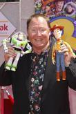 John Lasseter and Walt Disney