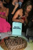 Trina Poses With Her Fendi Purse Birthday Cake