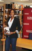 Venus Williams signs copies of her new book...