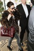 Victoria Beckham, Carrying A Rare Dark Red Crocodile Hermes Handbag and Arriving At Her Manhattan Hotel.