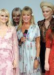 Pattie Boyd walks the catwalk in vintage clothing at a fashion show