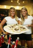 Promo girls at the opening of a new family run restaurant We the Pizza.