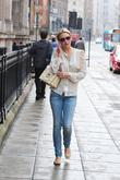 Alex Gerrard chats on her phone while walking...