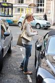 Alex Gerrard walking towards her car after going...