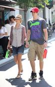 Adam Gregory and girlfriend Sheridan Sperry holding hands...