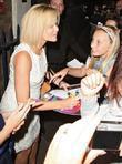 Amanda Holden signing an autograph Amanda Holden, who...