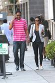Amerie  and a male companion out shopping...