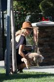 Ashley Tisdale leaves her mother's house with her...