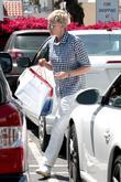 Ellen DeGeneres leaving Fred Segal with her wife...