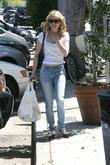 Emma Roberts paying into a parking meter before...
