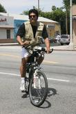 Erik Estrada is seen riding his bike through...