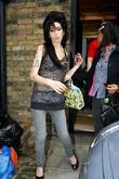 Amy Winehouse leaves her home this afternoon to...