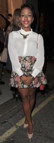 Alexandra Burke Fashion's Night Out 2011 - Louis...