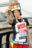 Uli Kilian (Most Rubik's cubes solved whilst running...