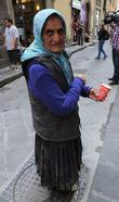 A gypsy woman attempted to beg for money...