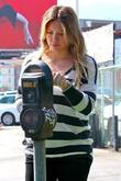 Hilary Duff pregnant actress paying a parking meter...