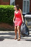 Imogen Thomas takes her rubbish outside before dropping...