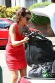 Imogen Thomas drops some unwanted clothes at Oxfam...