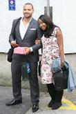 Pregnant Angelica Bell and husband Michael Underwood outside...