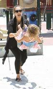A pregnant Jessica Alba enjoys the day playing...