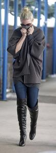 Katherine Heigl covers her face with her coat...