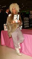 Katie Price aka Jordan signing copies of her...