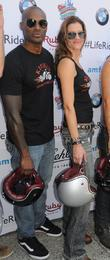 Tyson Beckford and Tricia Helfer