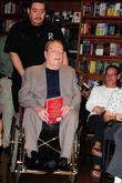 Larry Flynt arrives to his book signing for...