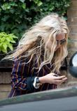Mary-Kate Olsen hides her face from paparazzi whilst...